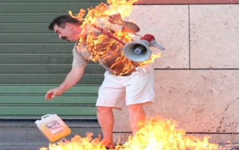 A Greek man burns himself alive as a protest against the AUSTERITY policies which have attempted to heal the economic crisis by deleting the middle classes from society and making rich bankers even richer. The Economic Crisis was never created by the PEOPLE - and yet it has been used as an excuse to economic enslave the working classes